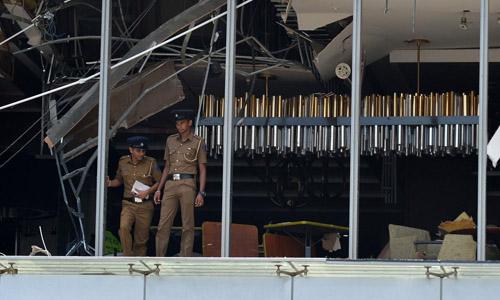 Cảnh sát tại hiện trường vụ đánh bom khách sạn Shangri-La, thành phố Colombo, Sri Lanka. Ảnh: AFP.