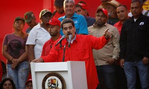 Tổng thống Venezuela Nicolas Maduro phát biểu trong một cuộc mít tinh ngày 1/5 ở Caracas. Ảnh: Reuters.
