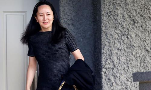 Giám đốc tài chính Huawei Mạnh Vãn Chu rời nhà riêng ở Vancouver, Canadahôm 8/5. Ảnh: Reuters.