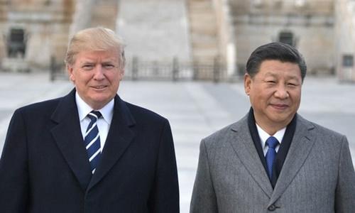 Tổng thống Mỹ Donald Trump (trái) và Chủ tịch Trung Quốc Tập Cận Bình tại Bắc Kinh hồi tháng 11/2017. Ảnh: AFP.