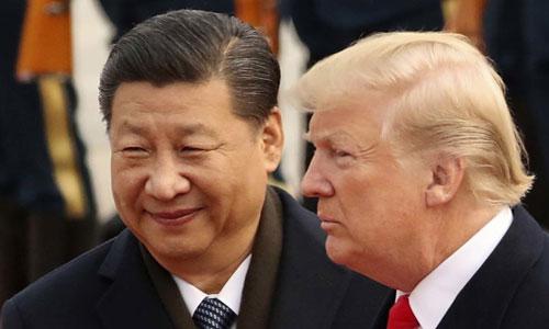 Tổng thống Mỹ Donald Trump (phải) và Chủ tịch Trung Quốc Tập Cận Bình trong cuộc gặp ở Bắc Kinh năm 2017. Ảnh: Reuters.