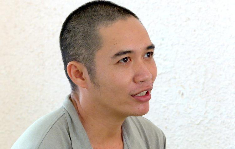 Đinh Công Lý tại cơ quan công an. Ảnh: Quang Bình.