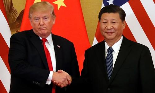 Tổng thống Mỹ Trump (trái) và Chủ tịch Trung Quốc Tập Cận Bình ở Bắc Kinh tháng 11/2017. Ảnh: Reuters.