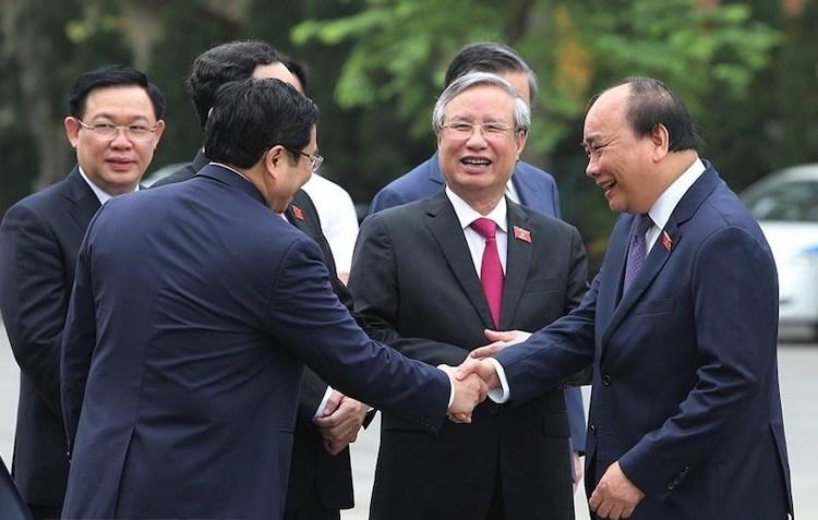 Từ phải qua: Thủ tướng Nguyễn Xuân Phúc, Thường trực Ban bí thư Trần Quốc Vượng và các vị lãnh đạo trước giờ khai mạc kỳ họp Quốc hội.Ảnh: TTX