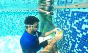 Chàng trai Ấn Độ lập kỷ lục thế giới 'lặn và xoay rubik'