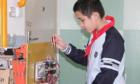 Cậu bé Trung Quốc sáng chế giàn phơi tự động sau lần bị mẹ mắng
