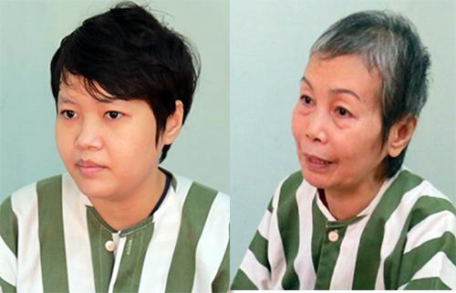 Phạm Thị Thiên Hà (trái)vàTrịnh Thị Hồng Hoa (mẹ của Hà) sau khi bị bắt giam. Ảnh: Nguyệt Triều.