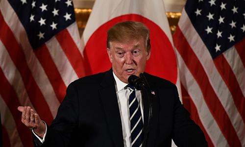 Tổng thống Mỹ phát biểu trong một cuộc gặp các lãnh đạo doanh nghiệp ở Tokyo hôm 25/5. Ảnh: AFP.