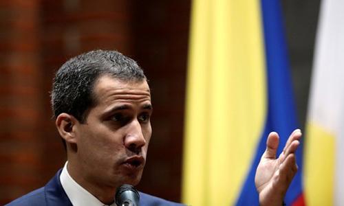 Juan Guaido phát biểu tại một hội nghị ở Đại học Công giáo Andres Bello tại Caracas, Venezuela hôm 24/5. Ảnh: Reuters.
