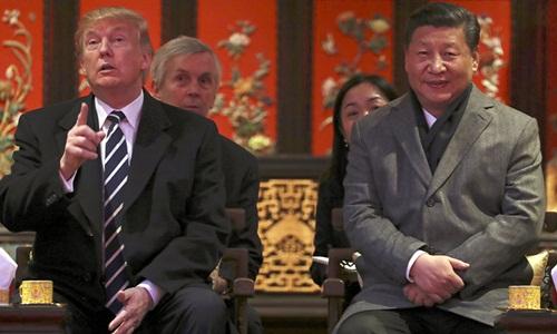 Tổng thống Mỹ Donald Trump (trái) và Chủ tịch Trung Quốc Tập Cận Bình trong cuộc gặp tại Bắc Kinh năm 2017. Ảnh: AP.