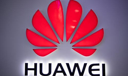 Logo Huawei tại một cửa hàng ở Bắc Kinh, Trung Quốc hôm 27/5. Ảnh: AFP.