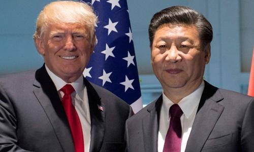 Tổng thống Mỹ Trump (trái) và Chủ tịch Trung Quốc Tập Cận Bình tại hội nghị G20 ở Đức năm 2017. Ảnh: Reuters.