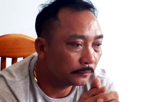 Ông trùm gỗ lậu Phan Hữu Phượng tại cơ quan điều tra. Ảnh: Thiện Nhân.