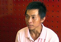Nguyễn Minh Nhựt tại cơ quan điều tra. Ảnh: An Phú