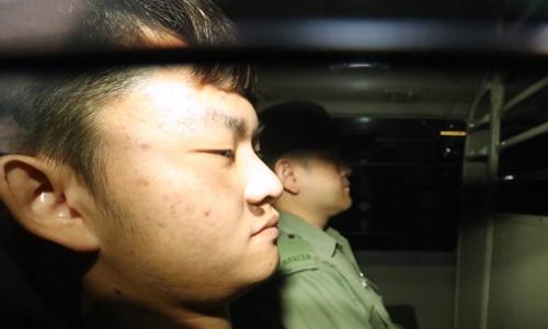 Chan Tong-kai (phía trước)tại Hong Kong năm 2018. Ảnh: SCMP.
