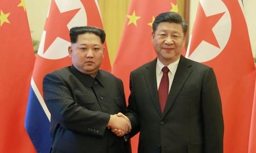 Chủ tịch Trung Quốc Tập Cận Bình (phải) và lãnh đạo Triều Tiên Kim Jong-un ở Bắc Kinhtháng 3/2018. Ảnh:KCNA.