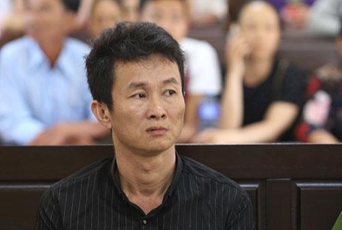 Bị cáo Huỳnh Ngọc Việt. Ảnh: Đắc Thành.