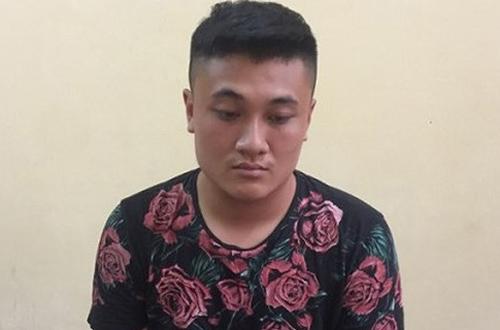Nghi phạm Nguyễn Thành Trung tại trụ sở công an. Ảnh: L. Nhi.