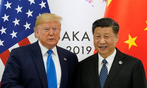 Tổng thống Mỹ (trái) và Chủ tịch Trung Quốc trước cuộc gặp sáng 29/6. Ảnh: Reuters.