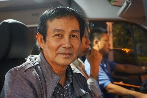 Ông Đoàn Văn Phương trên đường về Thủ Thiêm. Ảnh: Gia Chính