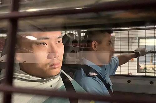 Pun Ho-chiu khi bị cảnh sát bắt giữ sau khi tham gia biểu tình. Ảnh: RTHK