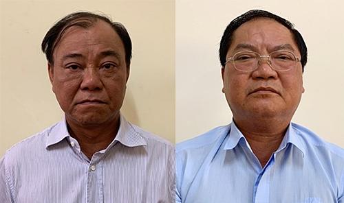 Ông Lê Tấn Hùng (trái) và Nguyễn Thành Mỹ tại cơ quan điều tra. Ảnh:Bộ Công an