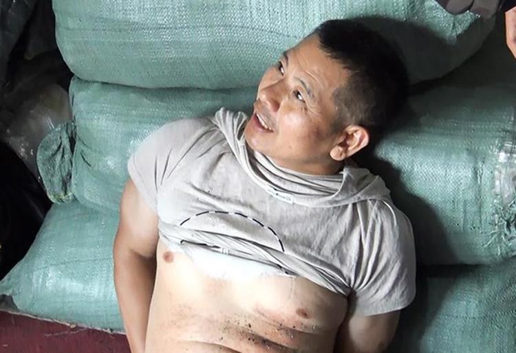 Nghi can người Trung Quốc bị bắt. Ảnh: Pháp luật TP HCM.