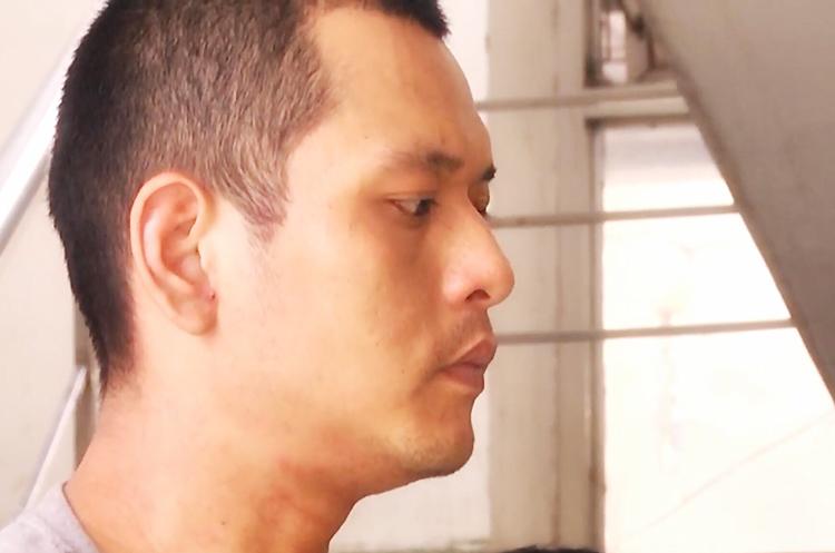 Nghi can Đài Loan bị bắt cùng hơn 1,1 tấn hàng đá tại Sài Gòn. Ảnh: Công an cung cấp.