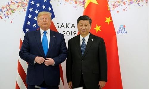 Tổng thống Mỹ Donald Trump (trái) gặp Chủ tịch Trung Quốc Tập Cận Bình sáng 29/6. Ảnh: Reuters.