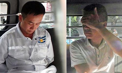 Dang Van Hanh (trái) và nghi phạm Singapore Richard Goh Chee Keong khi bị buộc tội vào năm ngoái. Ảnh: Straits Times