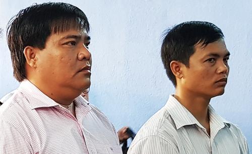 Phương (bên trái) và Thanh nghe tuyên án. Ảnh: Bảo An.