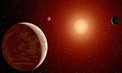Hệ ba hành tinh quay quanh sao lùn đỏ cách Trái Đất 73 năm ánh sáng. Ảnh: Science Alert.