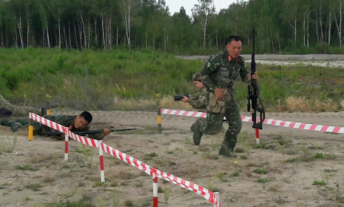 Xạ thủ Việt Nam thi đấu hôm 11/8. Ảnh: QĐND.