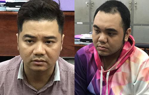 Hai anh em Trung tại cơ quan điều tra. Ảnh: Q.T