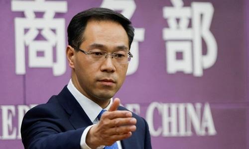 Phát ngôn viên bộ Thương Mại Trung Quốc Gao Feng trong cuộc họp báo tại Bắc Kinh tháng 4/2018. Ảnh: Reuters.