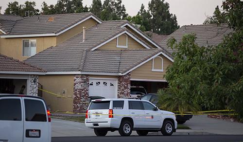 Cảnh sát phong toả ngôi nhà của Linda Nguyễn ở thành phố Ontario, bang California hôm 20/8. Ảnh: SCNG