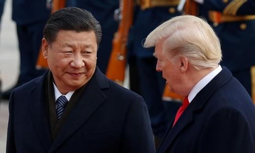 Chủ tịch Trung Quốc Tập Cận Bình (trái) và Tổng thống Mỹ Donald Trump. Ảnh: Reuters.
