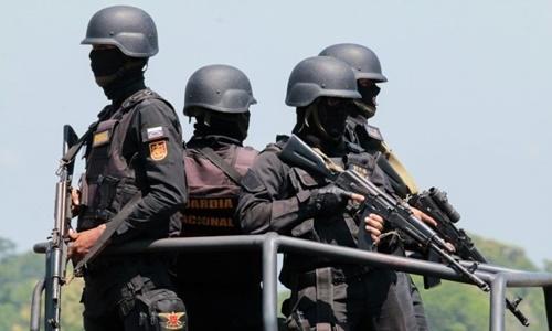 Các binh sĩ Venezuela tham gia cuộc tập trận tại sân bay ở La Fria ngày 10/9. Ảnh: AFP.