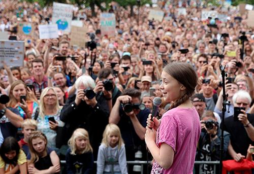 Thunberg phát biểu tại cuộc biểu tình chống biến đổi khí hậu ở Berlin, Đức hồi tháng 7. Ảnh: Reuters