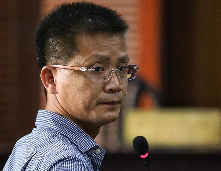 Ông Nguyễn Thanh Lâm trả lời HĐXX. Ảnh: Hữu Khoa.