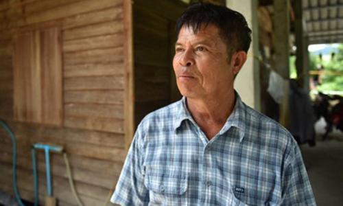 Kriangkrai Techamong tại căn nhà ông đang sống ở phía tây bắc Thái Lan. Ảnh: BBC.