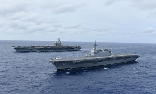 Tàu sân bay USS Ronald Reagan (CVN 76) cùng tàu sân bay trực thăng Izumo của Lực lượng Phòng vệ Hàng hải Nhật Bản (DH-183) tiến hành các hoạt động ở Biển Đông hồi tháng 6. Ảnh: US Navy.