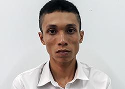 Cao Văn Nam tại cơ quan công an. Ảnh: An Bình