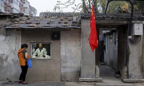 Cửa hàng bánh bao tại một con hẻm ở Bắc Kinh hồi tháng 10/2017. Ảnh: Reuters.