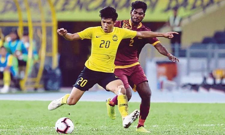 Syafig (áo vàng) lập hat-trick vào lưới Sri Lanka. Ảnh: NST.