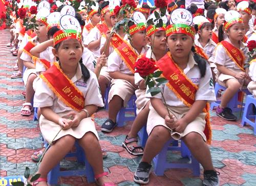 Các bé lớp 1trường Tiểu học Lê Văn Tám, quận 7, TP HCM, dự khai giảng năm học 2019-2020. Ảnh: Mạnh Tùng