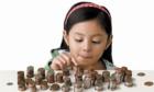 Cha mẹ không thể né tránh dạy con tiêu tiền