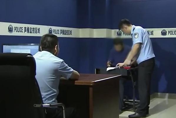 Lý tại cơ quan điều tra. Ảnh: CCTV.