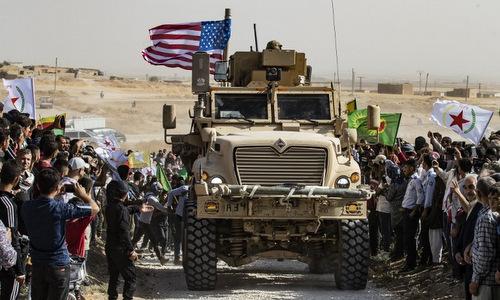 Xe thiết giáp Mỹ tại một căn cứ người Kurd ở miền bắc Syria hôm 6/10. Ảnh: AFP.