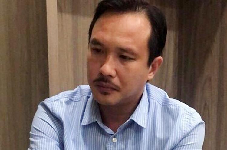 Nguyễn Hoàng Long tại cơ quan điều tra. Ảnh: Quốc Thắng.